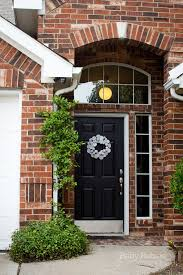front door makeover black door red brick modern wreath yarn wreaths are so not worth the time