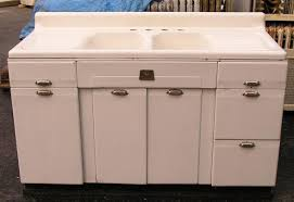 these double drainboard integral sinks in either a single or double sink model have a deck mounted faucet and a lower backsplash