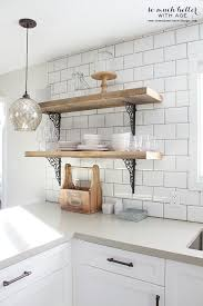 Rustic barn wood kitchen shelves | somuchbetterwithage.com