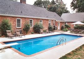 good inground fiberglass swimming pool design inspiration with s and wooden flooring in backyard garden