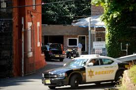 officials from the new jersey division of criminal justice searched the motor pool of the paic county sheriff s department in paterson on thursday
