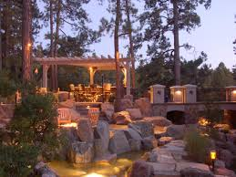 beautiful outdoor lighting. Decorative Outdoor Lighting Fixtures In A Patio With Natural Stones And Creek Beautiful