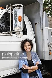 Plainpicture Plainpicture P1100m1575595 Hispanic Woman Truck