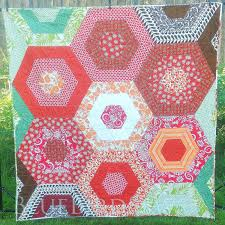 Blue Bird Sews: Hexagon Flower Garden Quilt: A Finish & Finishing a quilt is so satisfying. Putting the last stitches on a binding  and standing up to shake it out, lay it down on the floor and take a good  long ... Adamdwight.com