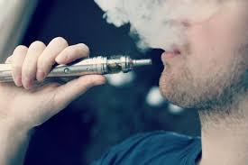 Image result for teen smoking a e-cigarette