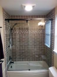 handmade tiles installed over a maax tub hydroslide shower glass also setup by the home artisan
