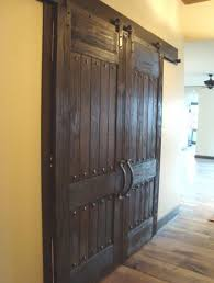 love these rustic barn doors the detailed decorative accents foyer and great room doors to dining