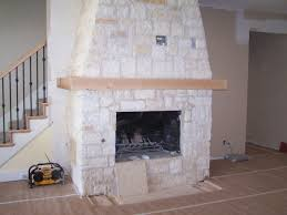 furniture impressing brown fireplace mantel design inspiration with white stone wall and bown floor tile nice