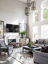 inspiration for a transitional open concept gray floor family room remodel in other with white walls