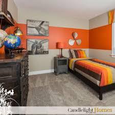 orange bedroom furniture. i like this light carpet dark furniture and the large stripe of orange itu0027s bedroom a