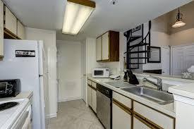 galley kitchen with pass through window at breakfast