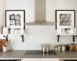 Traditional kitchen idea in Toronto with white cabinets, white backsplash,  stainless steel appliances,