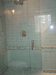amazing bathroom with corner glass shower with blue mosaic glass tile shower