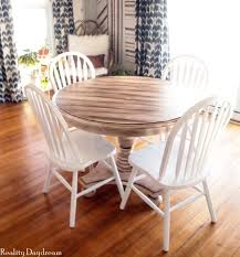 i love the distressed wood look with the crisp white chairs don t you think this would look amazing with just about any décor style