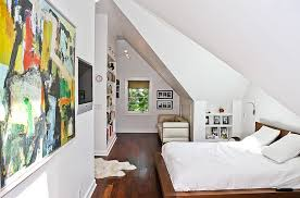View in gallery Add color to the attic room with some lovely wall art