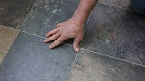 how to remove linoleum flooring from concrete installing tile over vinyl flooring on wood or concrete