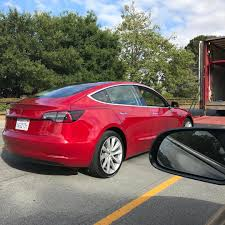 tesla new car releaseTesla Model 3 new red release candidate spotted at Tesla HQ