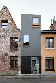 A narrow house squeezed in between two adjacent buildings in Gelukstraat,  Belgium. See more