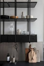 monochrome home with industrial touches digsdigs 1950s kitchen metal wall shelves