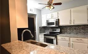 photo 2 of 10 kitchen with stainless steel appliances with granite countertops 4859 cedar