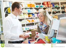 s clerk assisting w in pharmacy stock photo image  pharmacy chemist workers in drugstore stock image