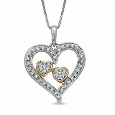 t w diamond embracing hearts pendant in sterling silver and 14k two