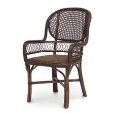 cane arm chair with lattice detail dining room