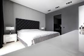 fashionable room with slate gray black bed with white furniture