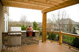 an azek deck with an outdoor kitchen in leawood built by retouch how much does a cost k67