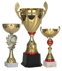 Спортивные награды в ассортименте кубки медали статуэтки  Спортивные награды в ассортименте кубки медали статуэтки дипломы