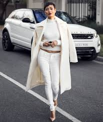 cream winter coat with all white outfit