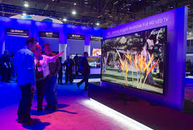 sharp 90 inch 4k tv. people look over a sharp aquos 90-inch hd led television during the 2014 international consumer electronics show (ces) in las vegas, nevada, january 7, 90 inch 4k tv r