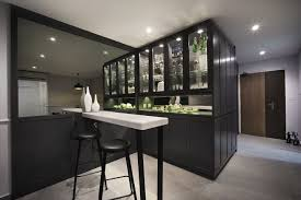 the bar area glistens just off the entrance with a custom designed dark timber and glass fronted display cabinet the bar area is completed with a