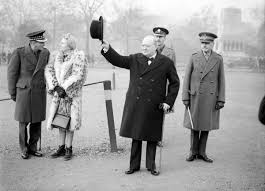th give us the tools to finish the job winston churchill raises his hat in salute during an inspection of the 1st american squadron of