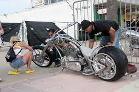 florida memory people buffing motorcycle for boardwalk chopper