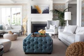 wonderful chic living room features a heather gray sofa facing deep blue tufted ottoman as coffee table52
