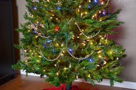 stand back and look at the tree make any adjustments to bead string such as making additional drapes beads on christmas tree n14