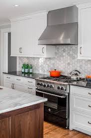 white cabinets accented with oil rubbed bronze pulls and a charcoal gray quartz countertop