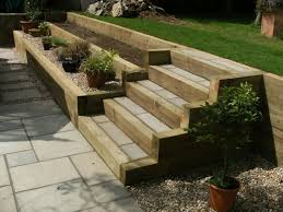 new softwood sleeper terraces and steps to structural retain and link garden levels