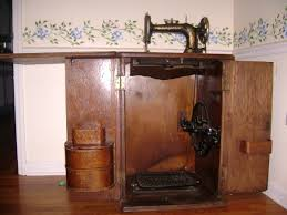New Home Sewing Machine in Cabinet circa late 1800s
