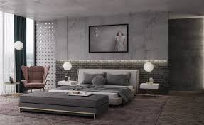 Join your ceiling and wall for a bedroom tres chic. Pendant baubles  illuminate a grey brick wall, low bed and nifty ottoman as a rug matches  the floor.