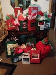 these gifts are wrapped and delivered to seniors and persons with diities that might not be remembered at volunteers help with donations
