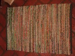green rag rug is hemmed