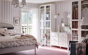 pink and white furniture. traditional bedroom with grey and white striped wallpaper pink floor wardrobes glass furniture