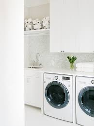 laundry room with toilet ideas laundry room transitional with white countertop storage baskets white countertop