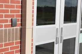 school doors. Doors At Tiffany Ridge Elementary, Kansas City, Mo., Have Minimal Exposed Hardware To Prevent Unauthorized Entry. (Architect: Hollis + Miller Architects). School O