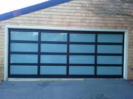 styleview black garage doors at night styleview black anodized frame with white laminate glass