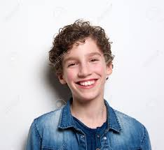 close up portrait of a cute boy laughing on white background stock photo 38947274