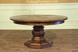 rustic expanding round table with self storing leaves solid walnut table with turned pedestal base