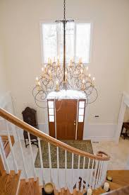chandelier placement is always important especially on sloped ceilings